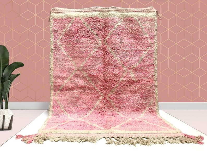 The pink rug with fringe