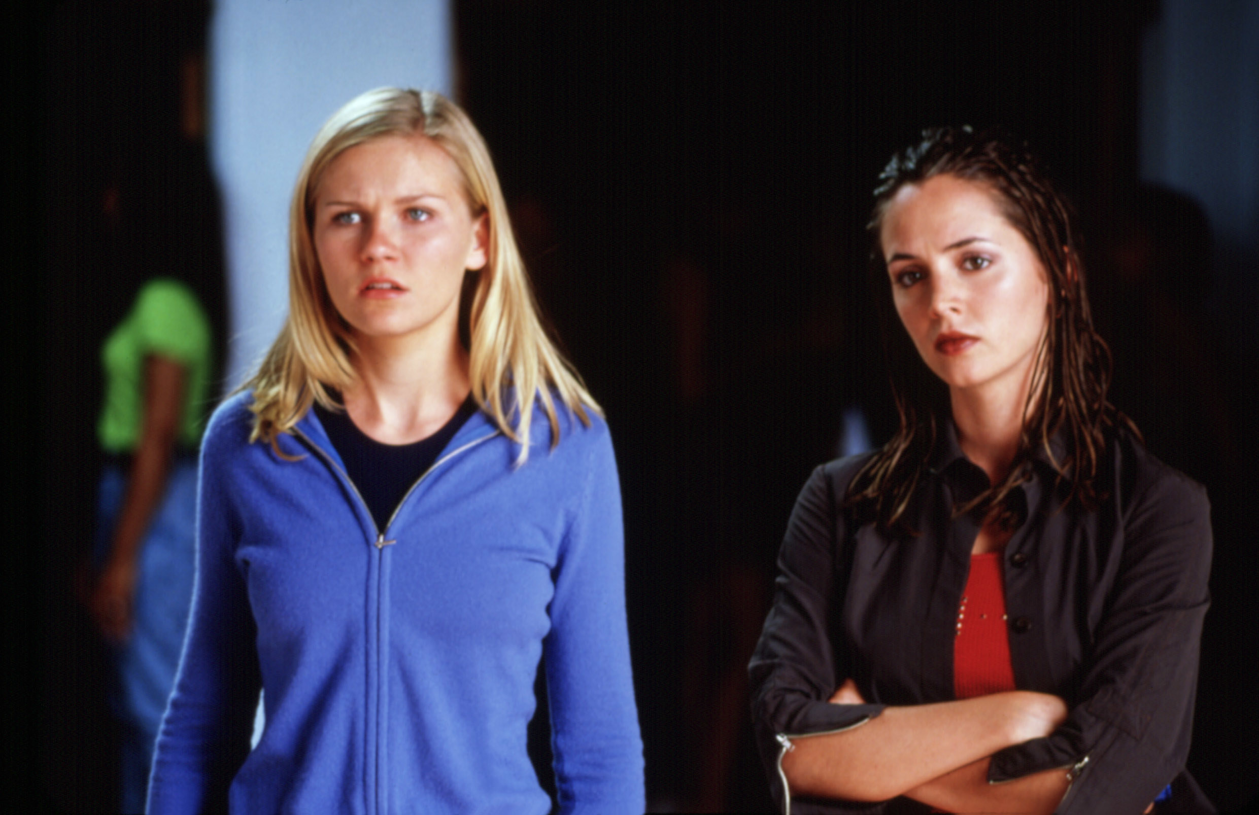 Kirsten and Eliza standing together in the movie