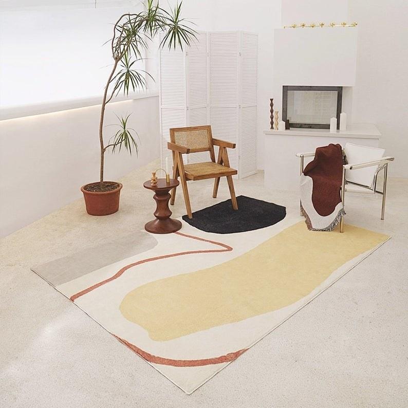 Cream rug with fringe and black geometric design