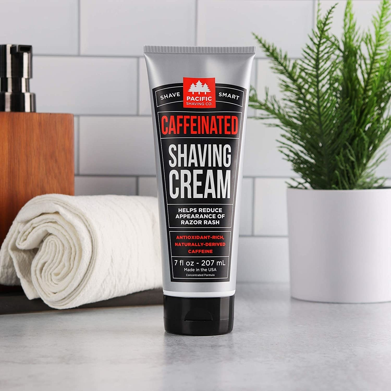 A tube of caffeinated shaving cream on a bathroom vanity