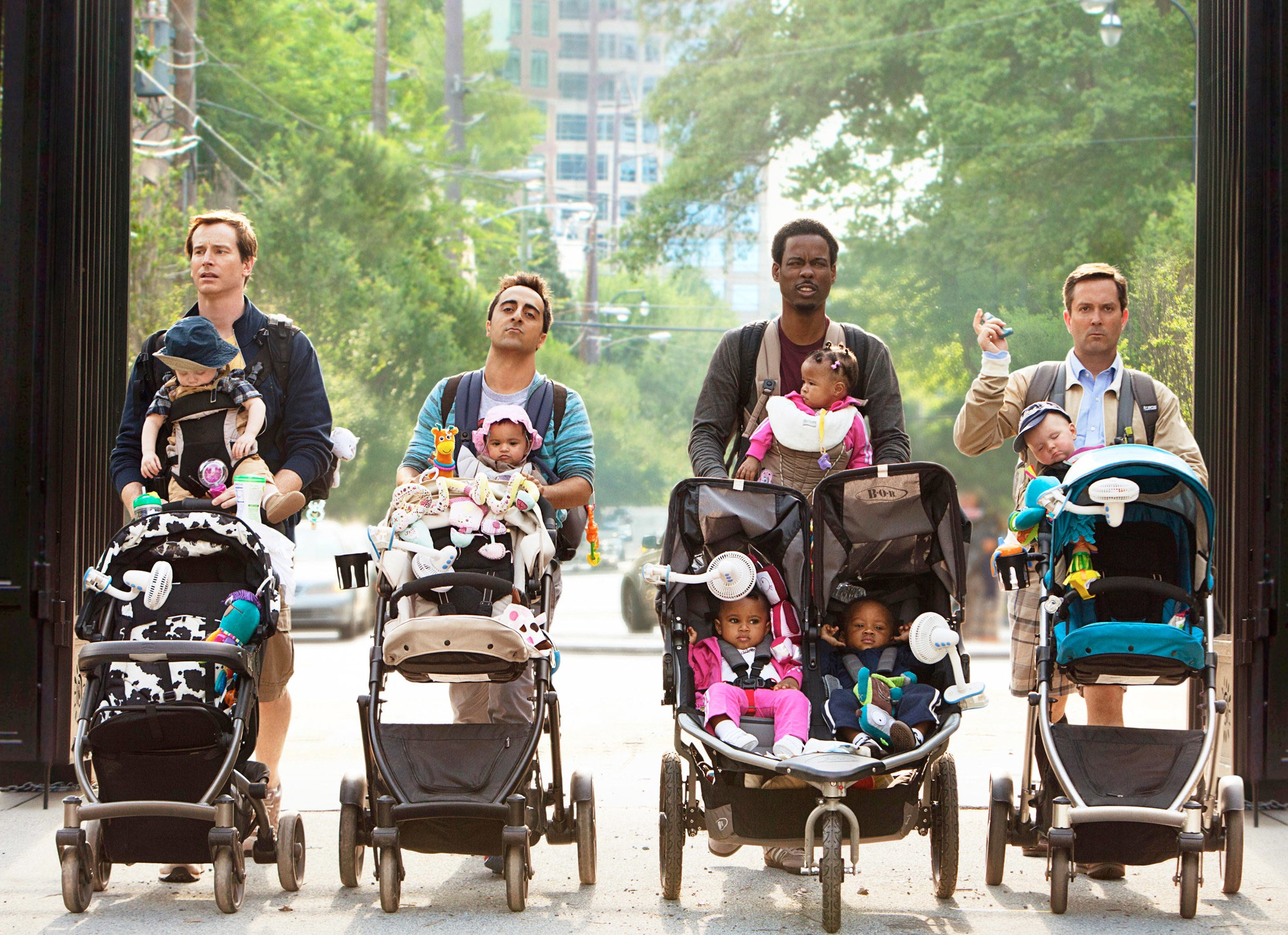 The dads walking with the babies