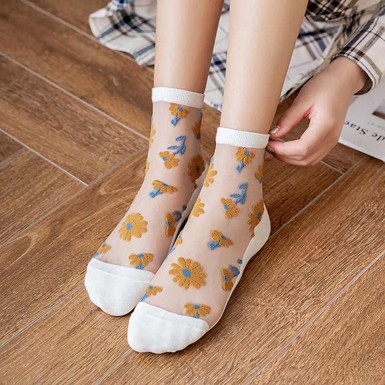 white sheer socks with yellow flowers on them