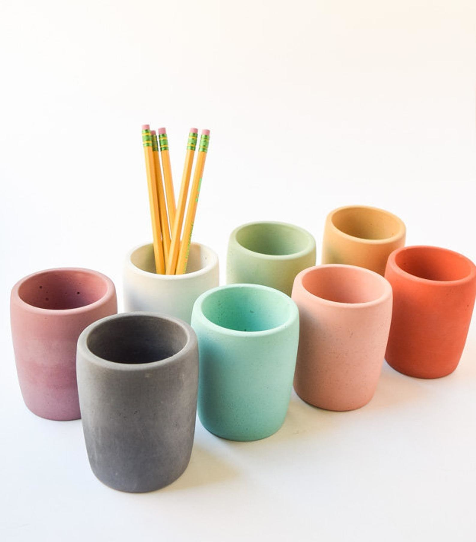 Eight concrete mugs in different colors