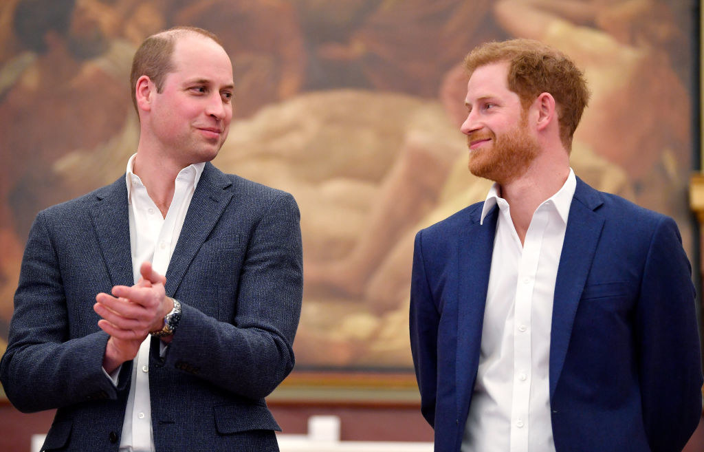 William and Harry smiling at one another during happier times