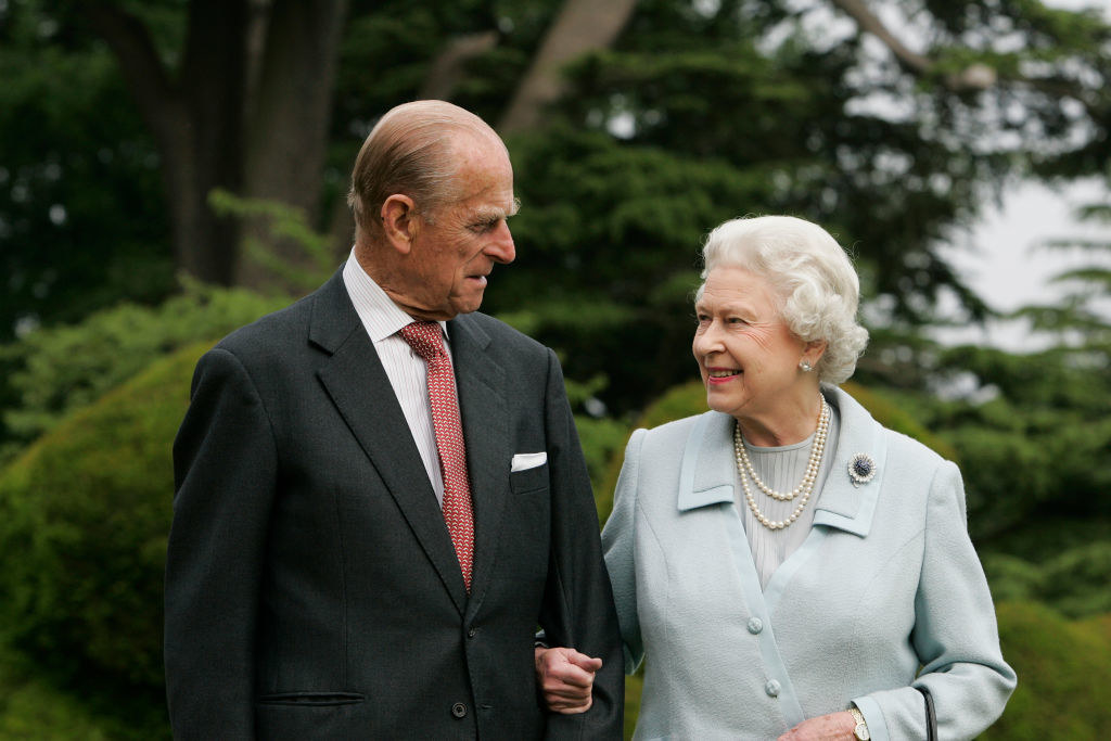 Prince Philip and the Queen standing outside arm-in-arm