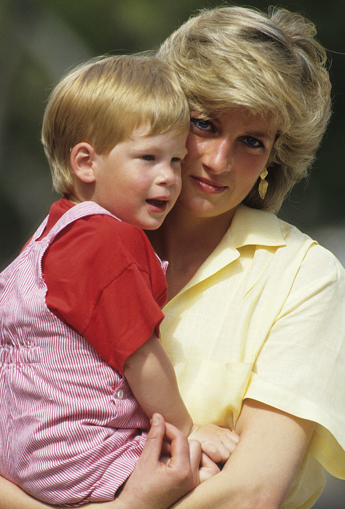 Princess Diana holding Harry in her arms when he was a toddler