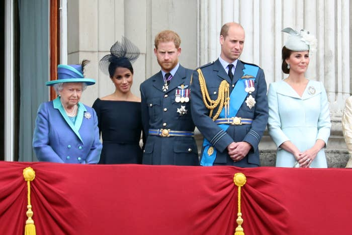Meghan and Harry stand with the Queen, William and Kate Middleton at an event
