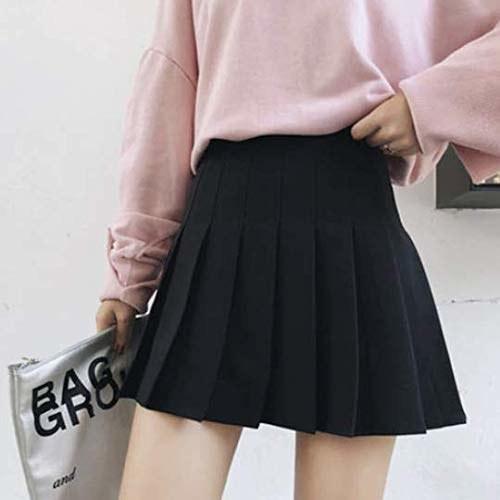 A model wearing a black tennis skirt.