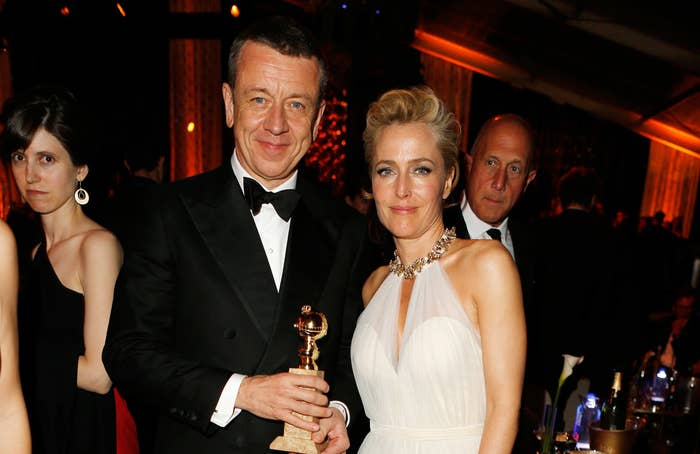 Peter stands with The Crown star Gillian Anderson