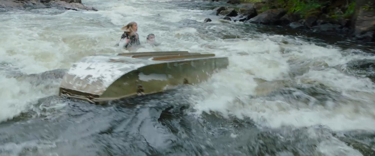 Todd, Viola, and Manchee's boat capsizes in the river