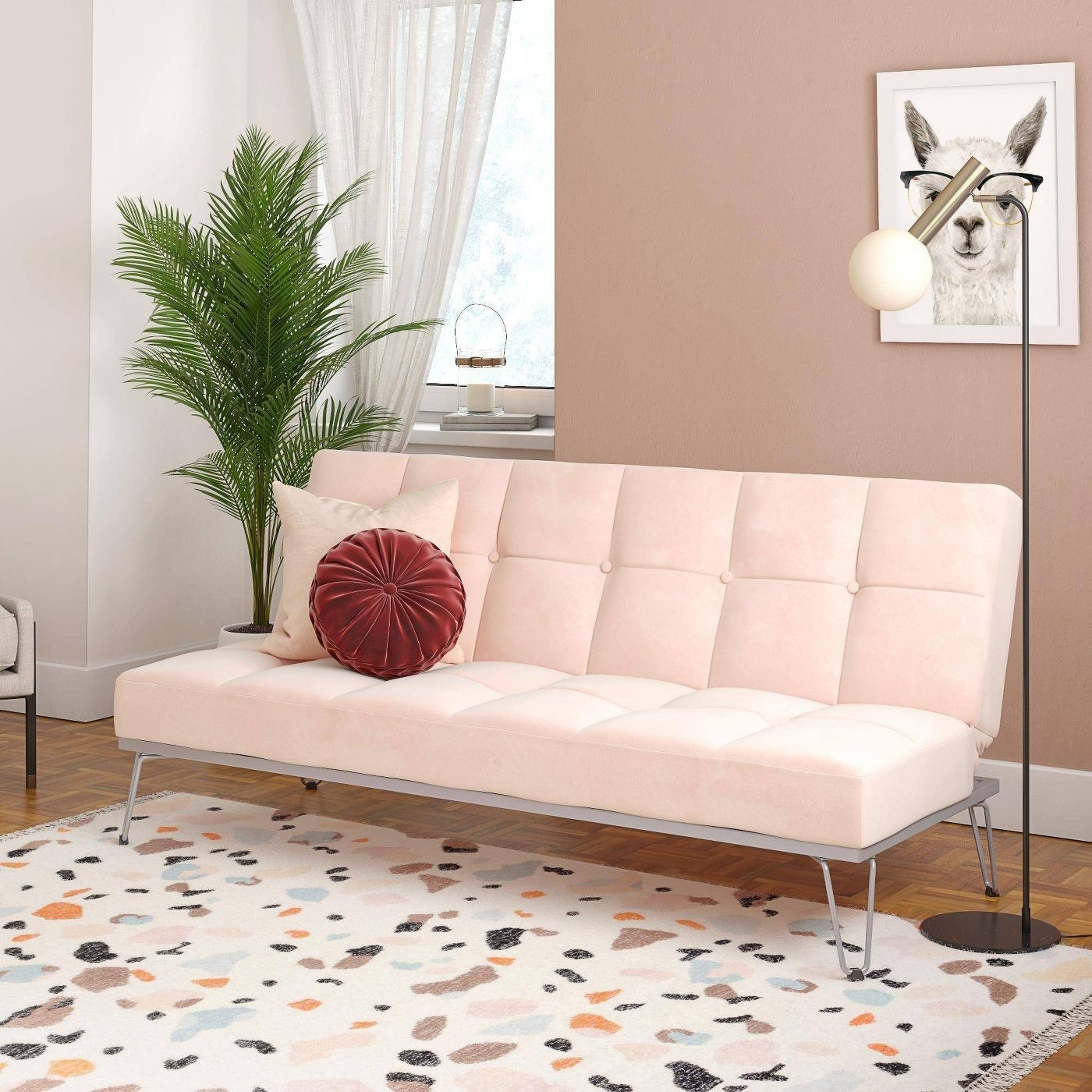 A pink couch in a home