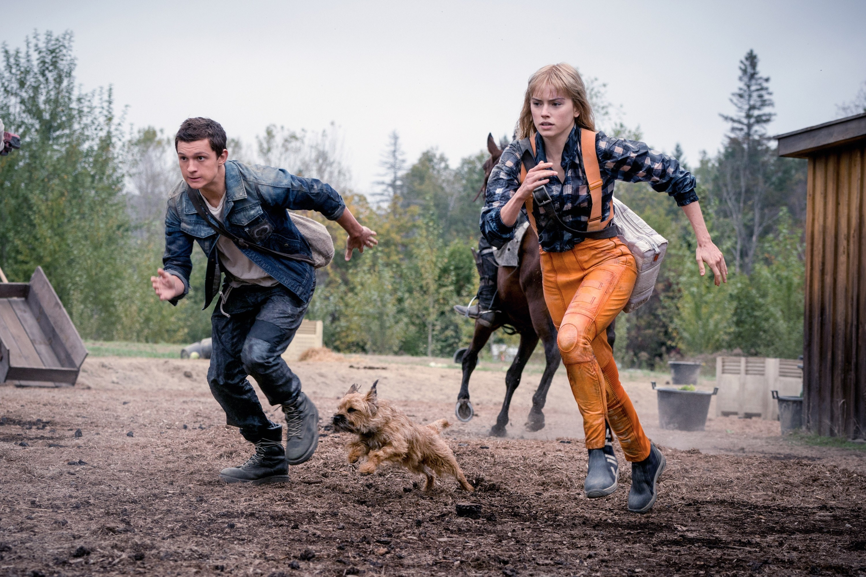 Todd, Viola, and Manchee running from the mayor and his men