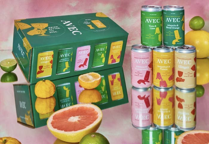 A case of the sample pack surrounded by fresh fruit