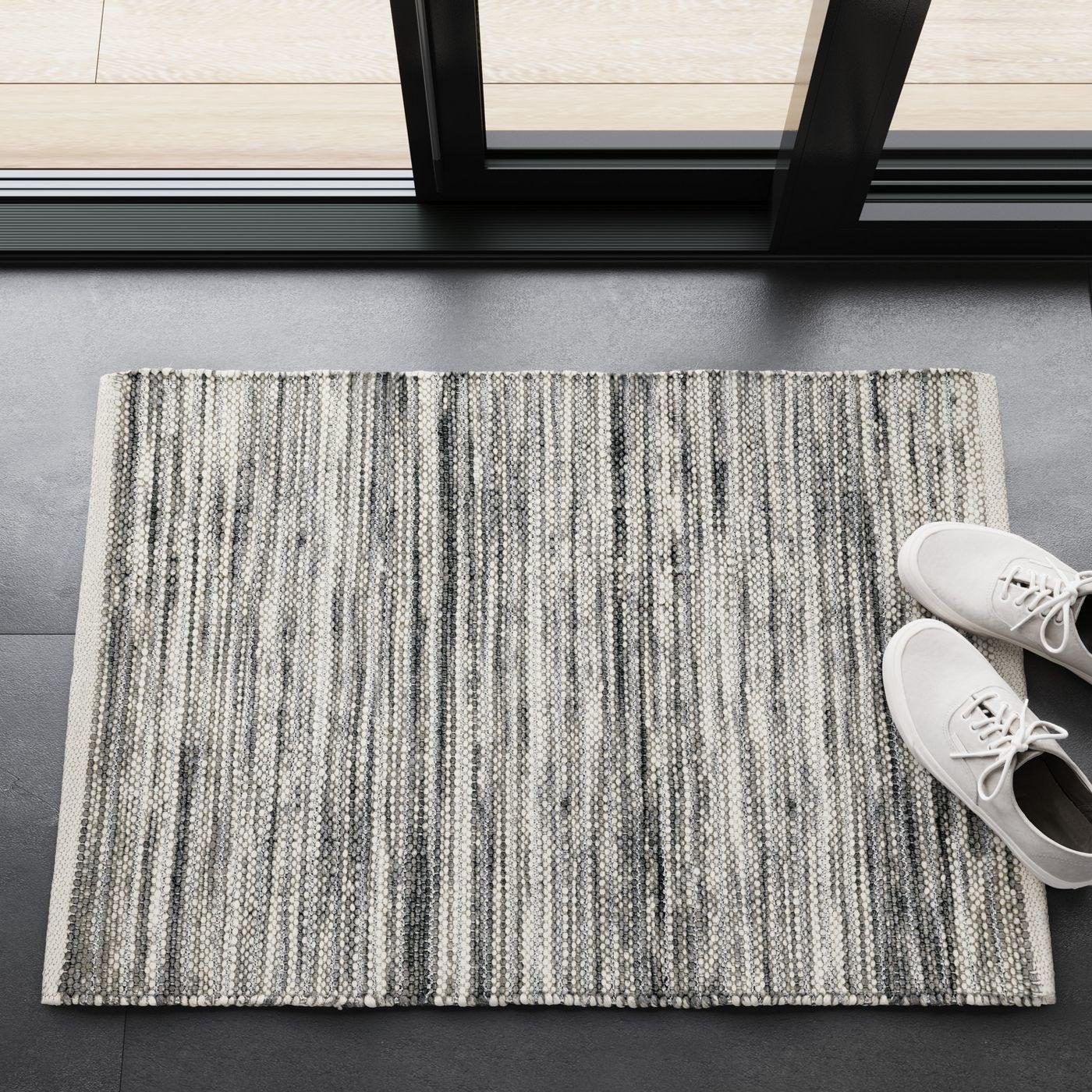 A metallic silver rug