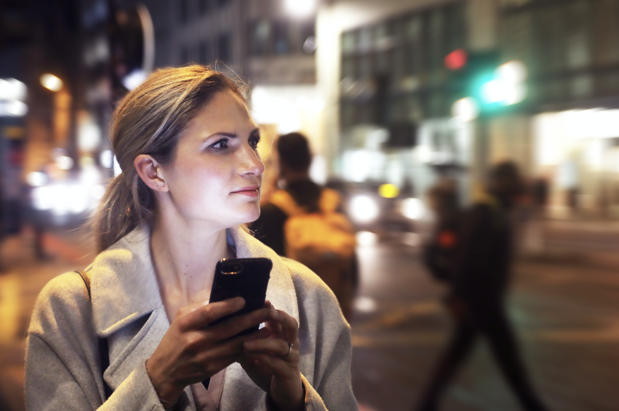 A woman receiving a text and making an uncomfortable face