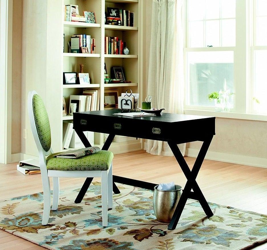 A black desk in someone's home