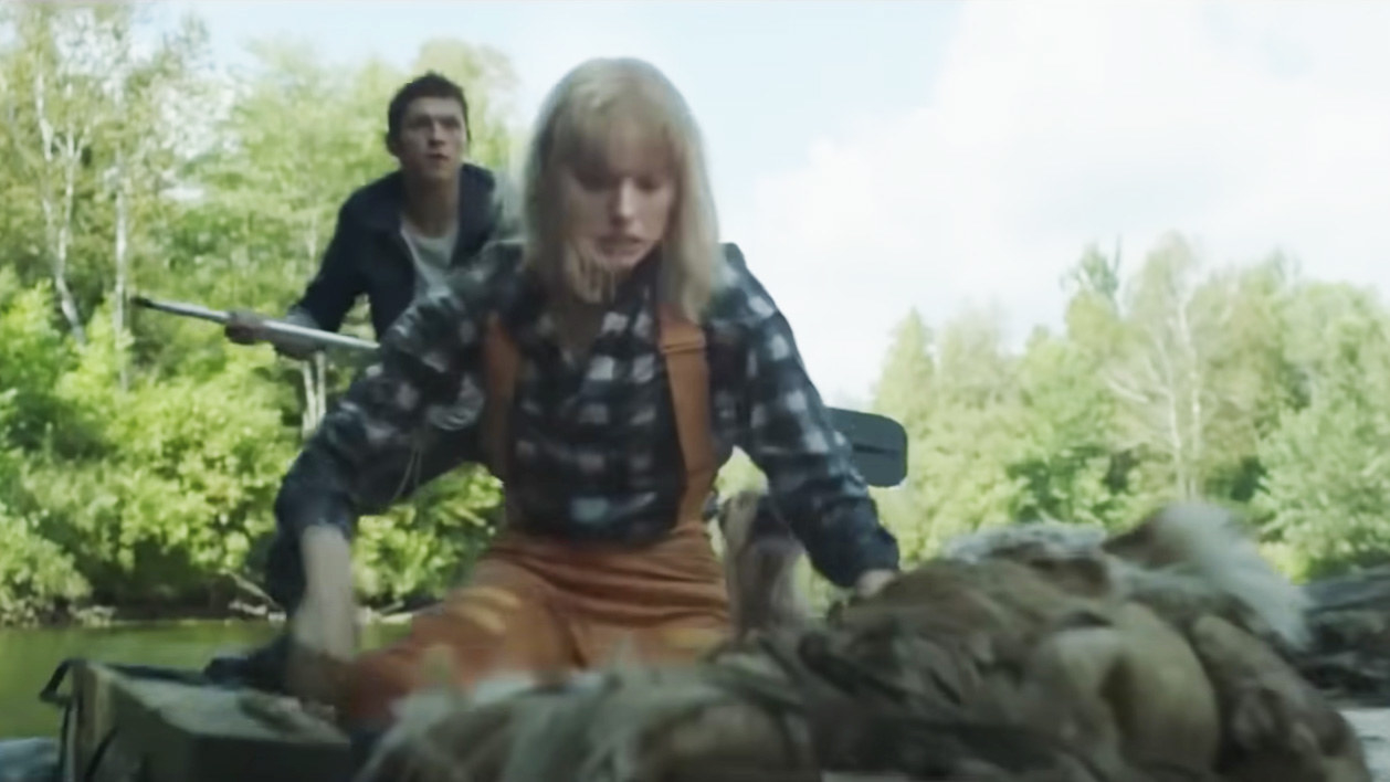 Todd, Viola, and Manchee escaping Aaron on the river