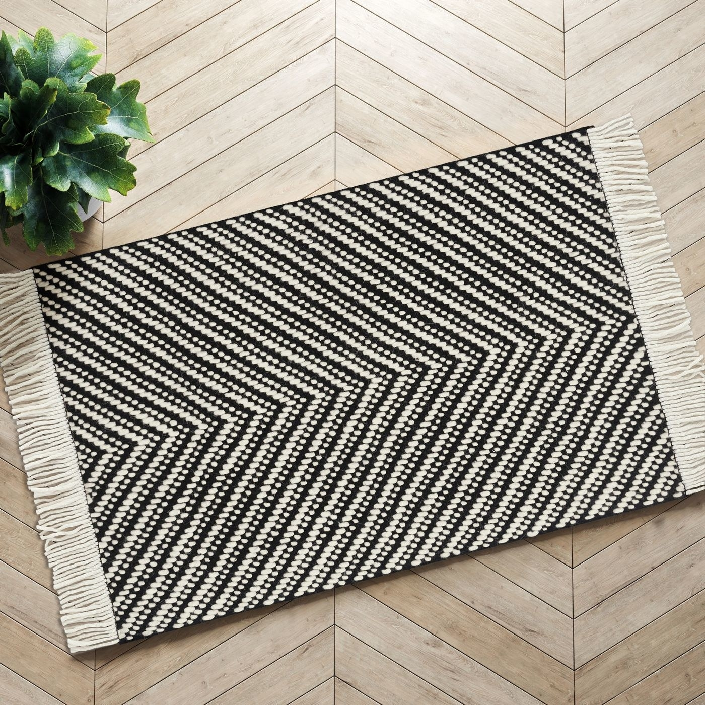 Floor with black and white chevron rug