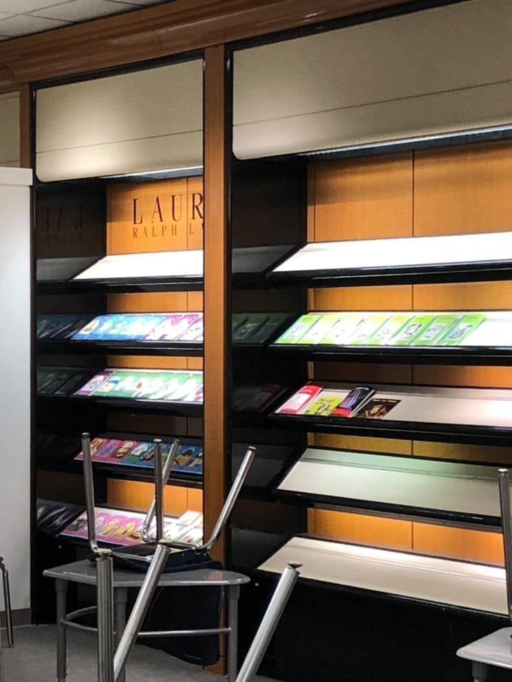 Shelves display reading materials under a Ralph Lauren sign
