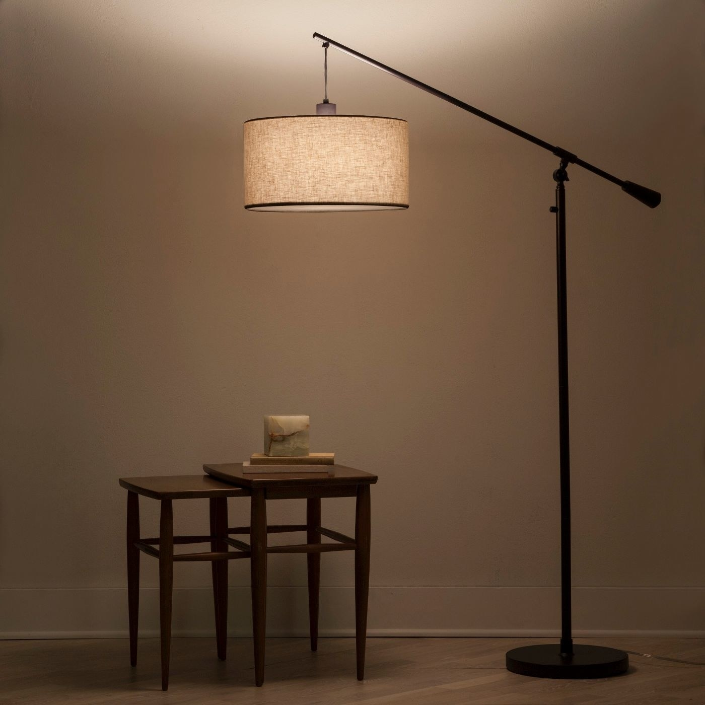 A room with a brown pendant style lamp
