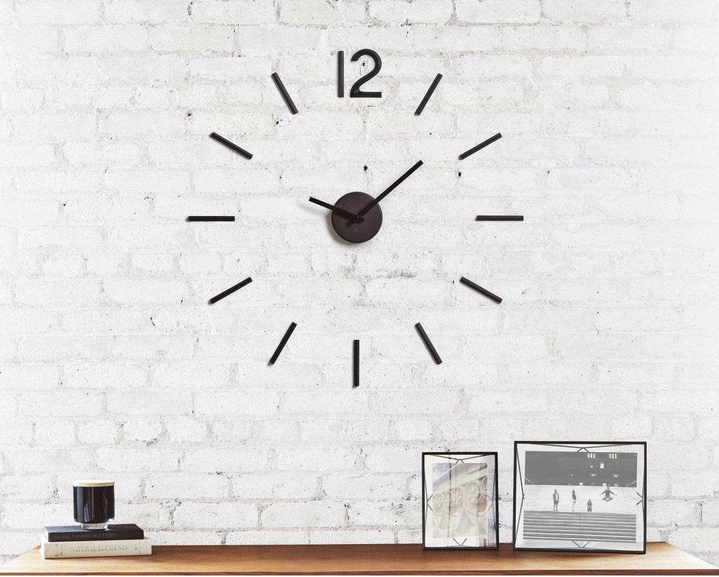 A modern black clock in a home