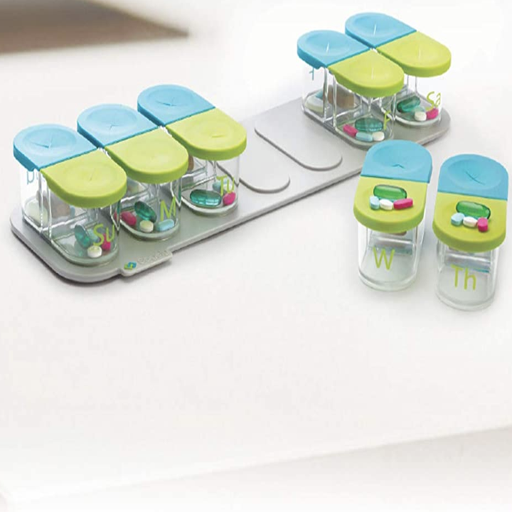 the pill organizer with slots for night and day of each day of the week that can be removed from the base