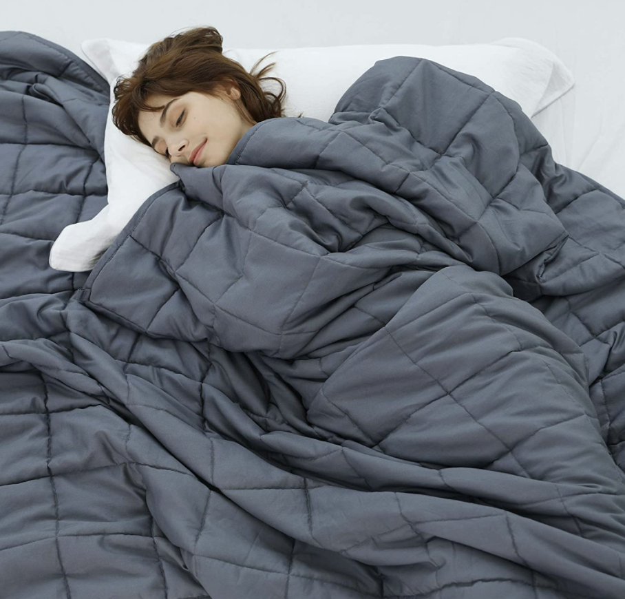 person using weighted blanket