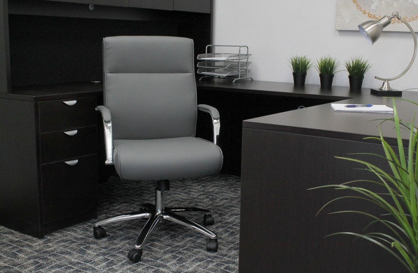 A grey chair in an office