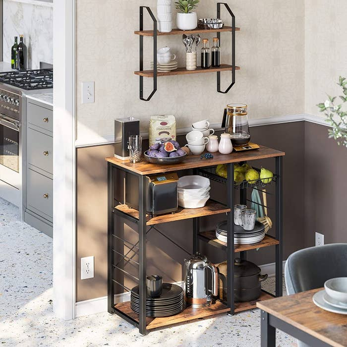 the kitchen rack with five wooden shelves