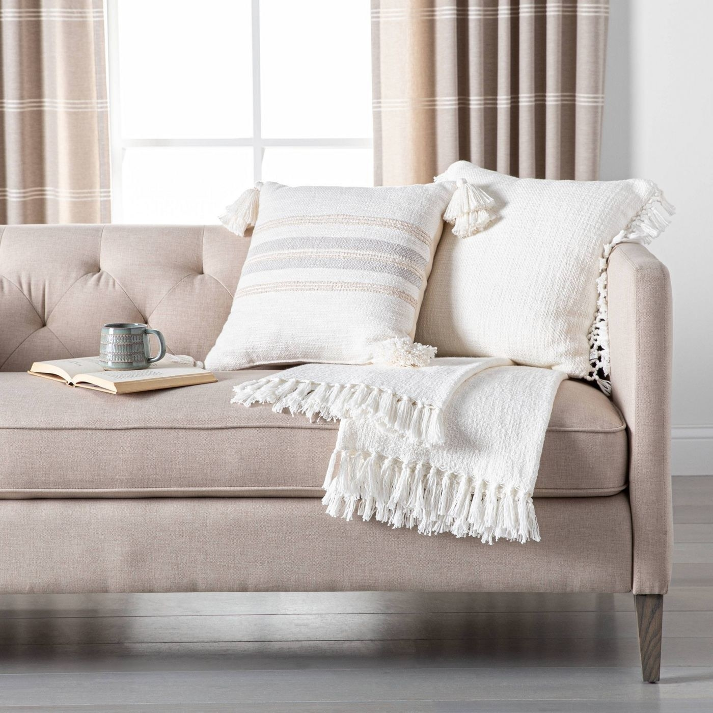 A white throw blanket on a couch