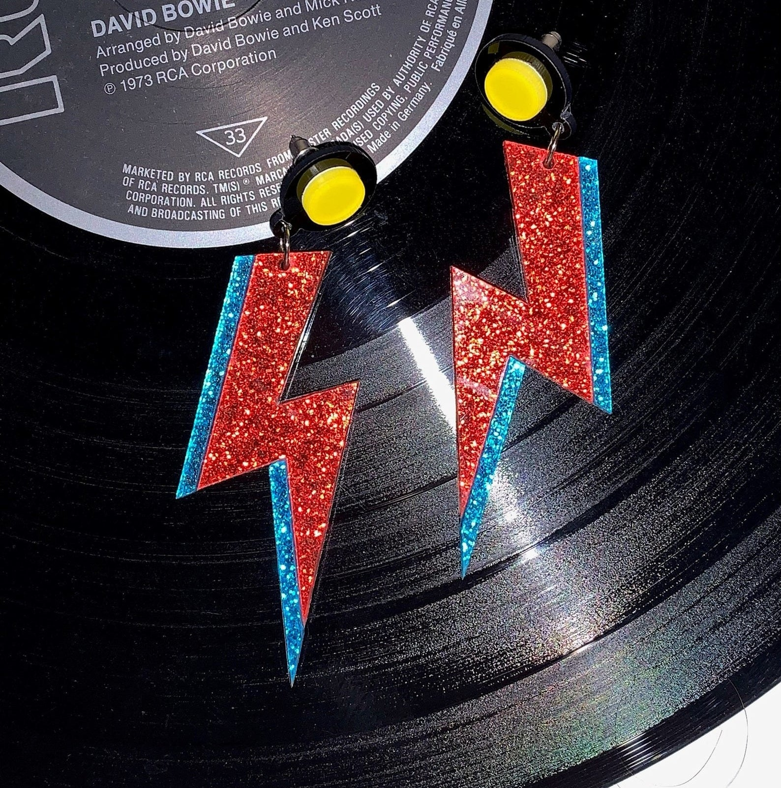 the red and blue lightning bot earrings