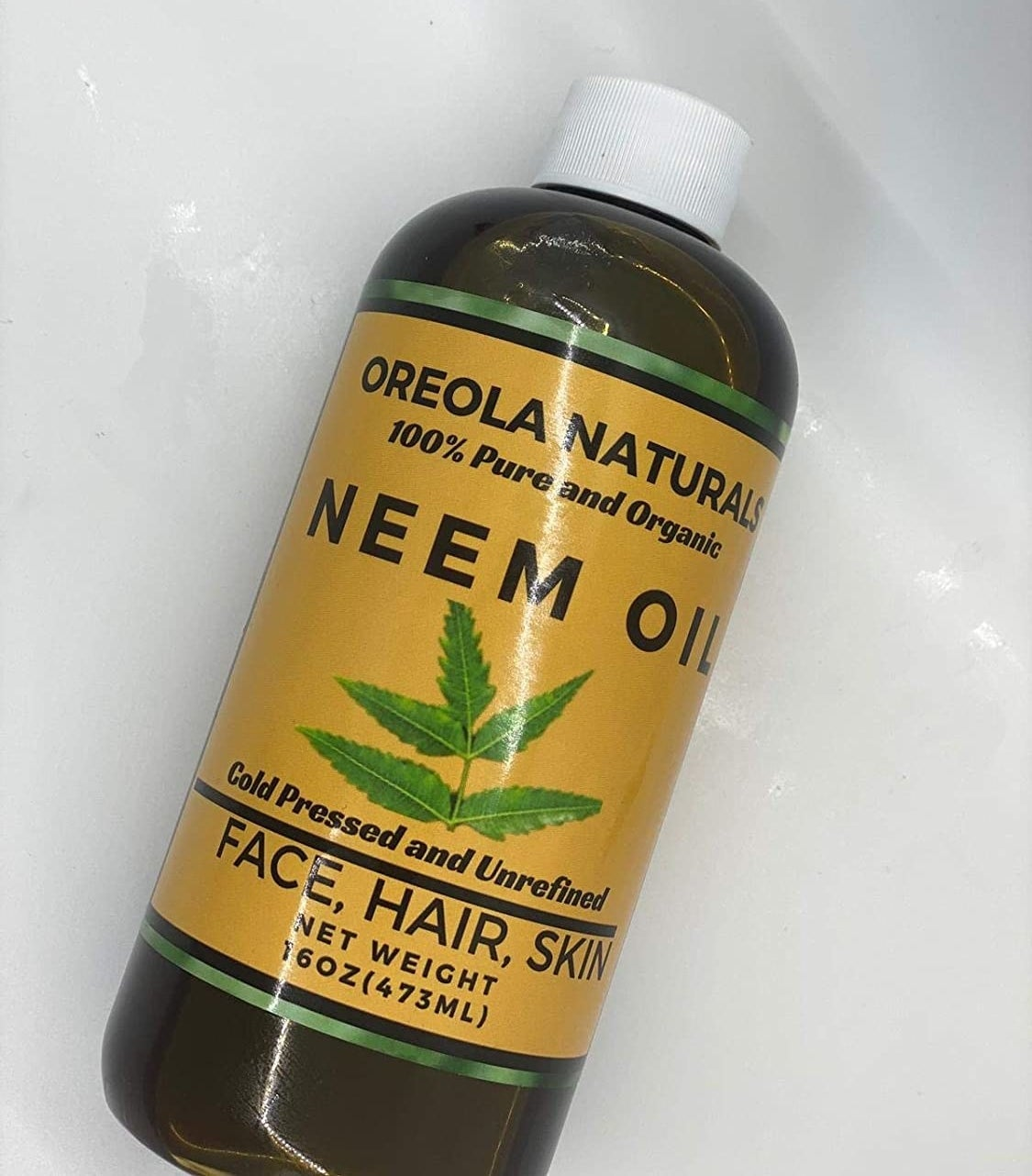 A bottle of organic cold pressed and unrefined neem oil
