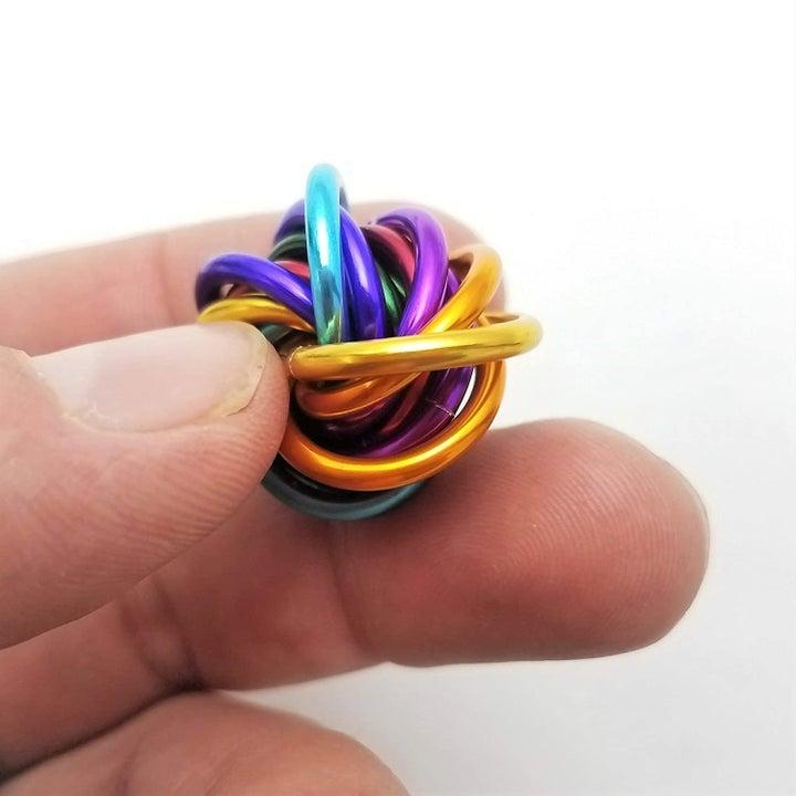 rainbow loop fidget toy in between fingers