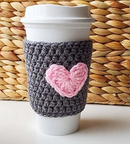 gray sleeve with a heart on white to-go disposable coffee cup