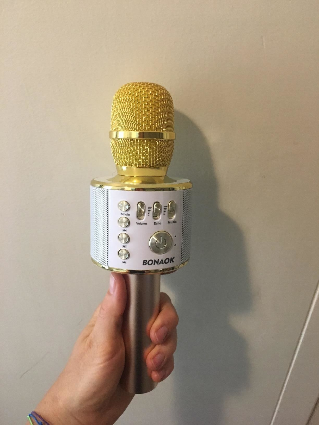 the karaoke microphone in white and yellow