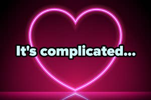 """""""It's complicated..."""" over a neon heart sign"""