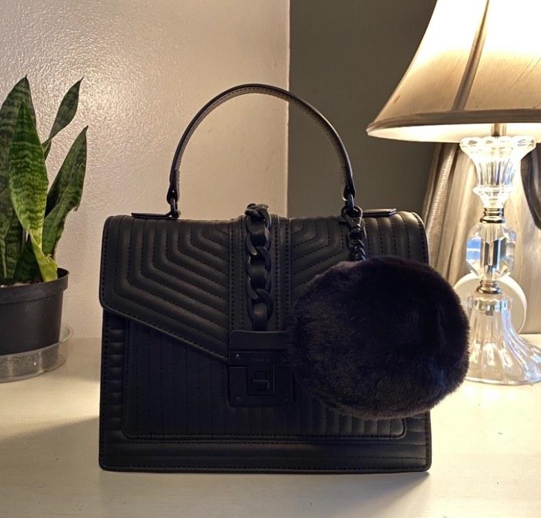 The handbag in black on a countertop