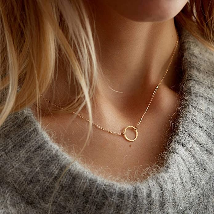 the gold necklace