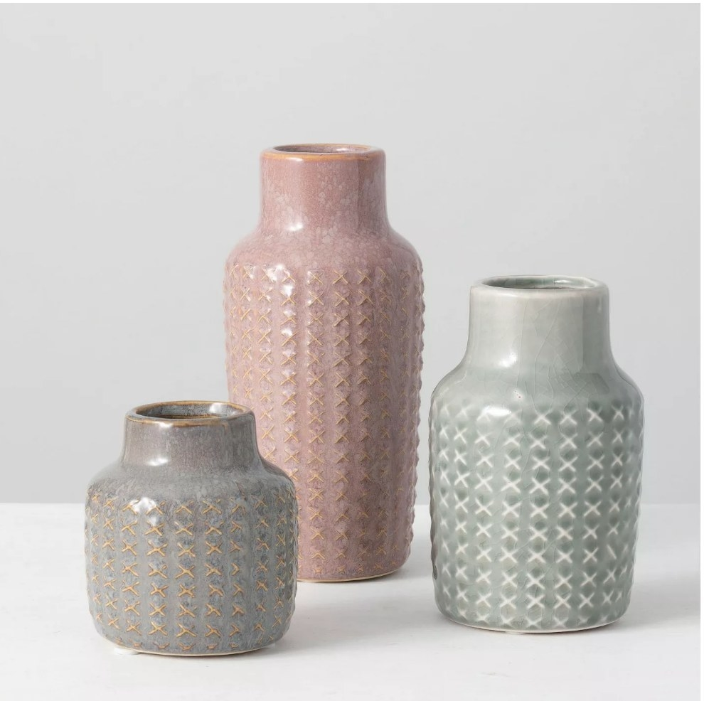 Set of three vases, gray, pink and green