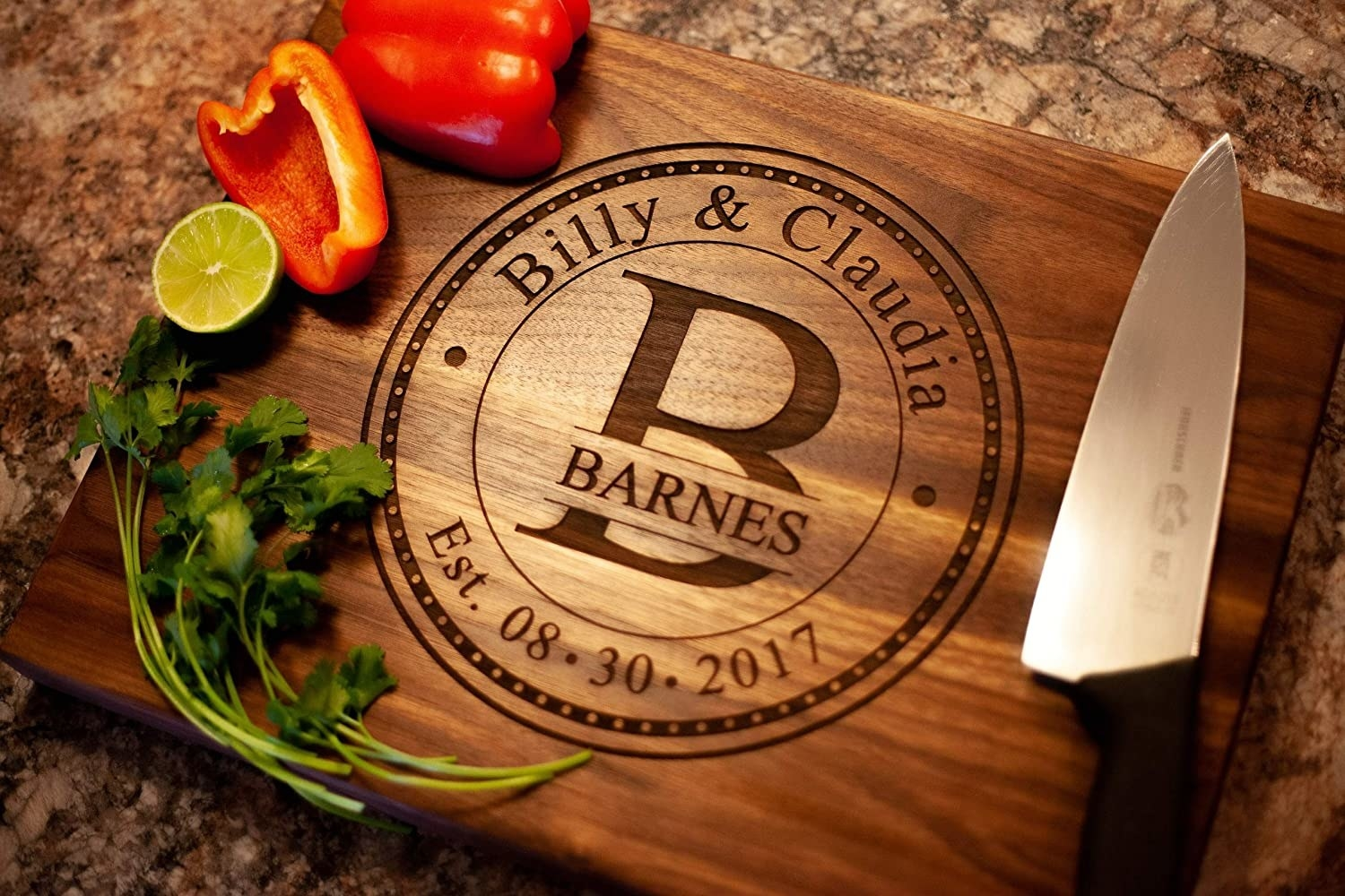 """the wooden cutting board with a knife and veggies that says """"Billy and Claudia Barnes"""""""
