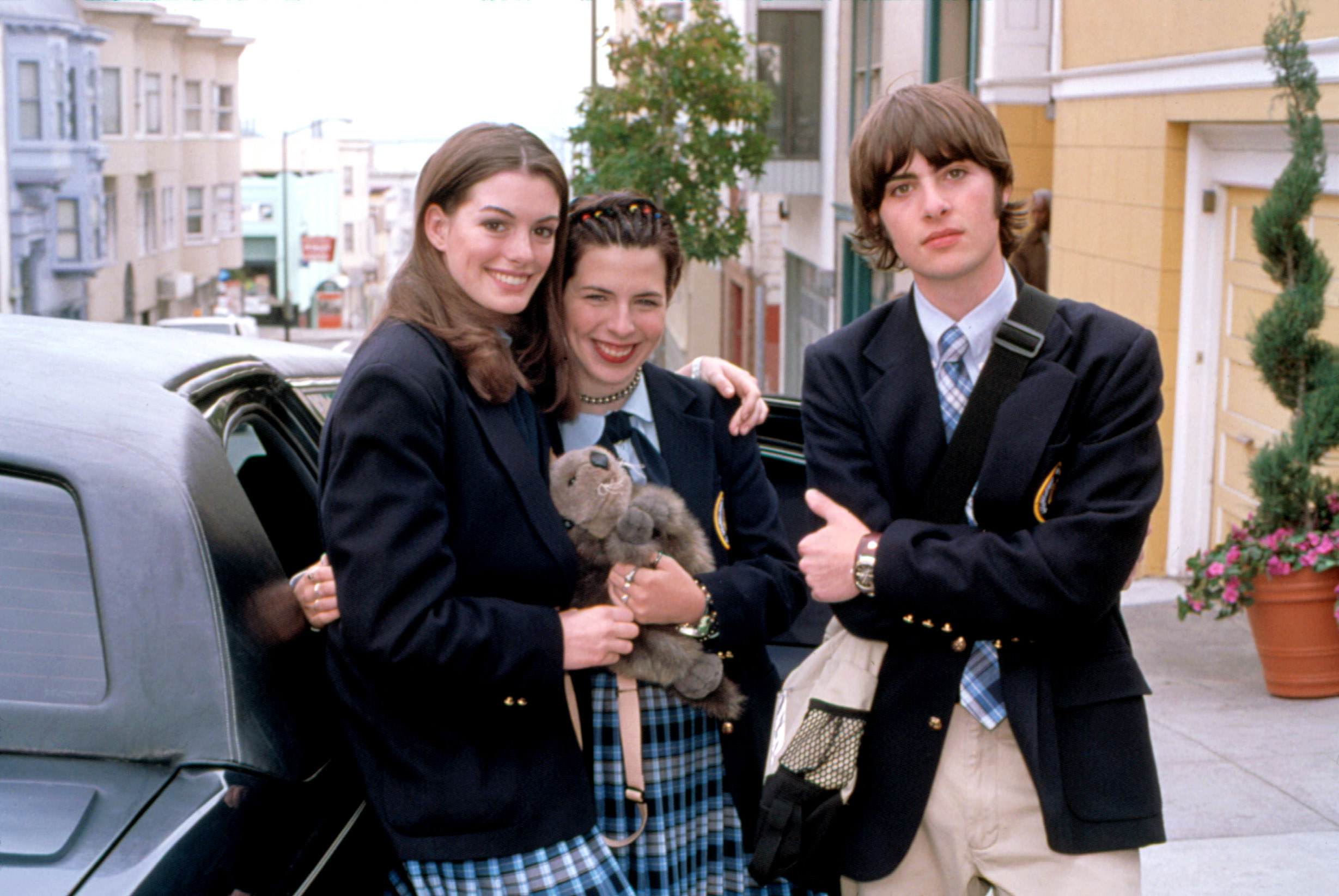 Mia, Lily, and Michael in the movie outside the limo