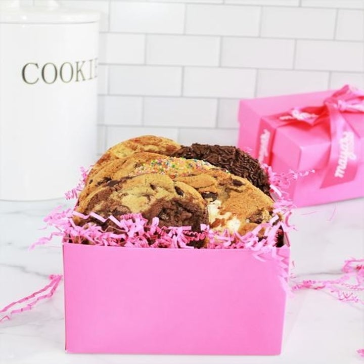 pink box filled with assorted cookies