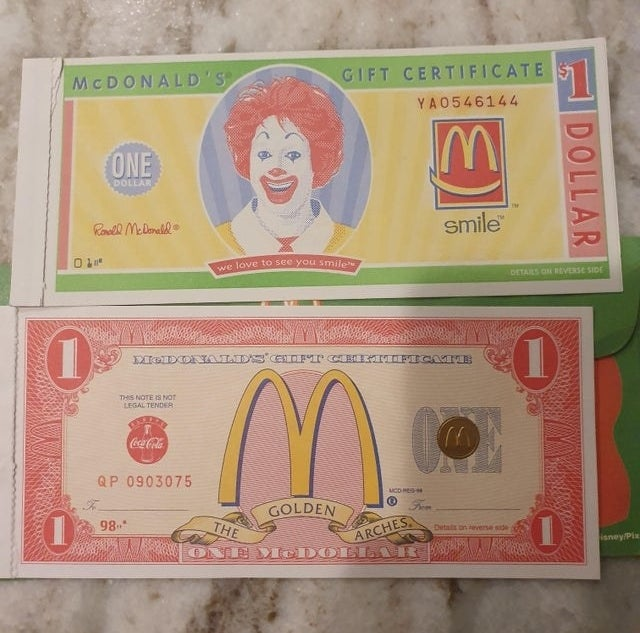 Two different one dollar McDonald's gift certificate