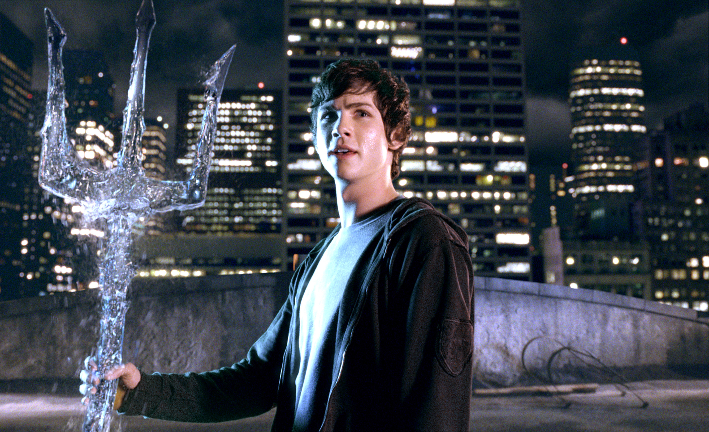 Logan holding a water trident in the film