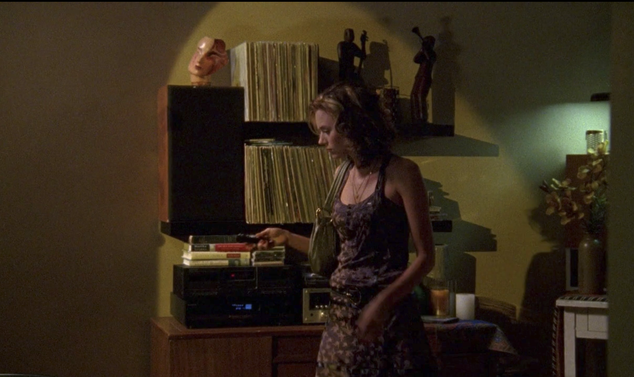 Peyton in her apartment with a bunch of records
