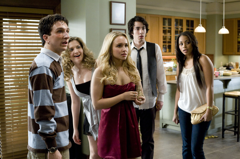 Hayden/Beth standing in the kitchen in the film