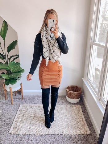 front view of a reviewer wearing the skirt in brown
