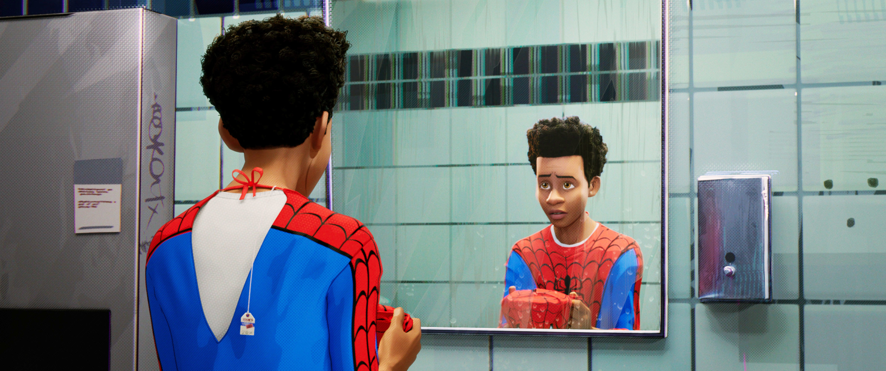 """Miles Morales looking at himself in a mirror in a scene from """"Spider-Man: Into the Spider-Verse"""""""