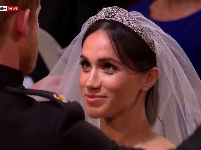 Meghan Markle looking up at Prince Harry on their wedding day