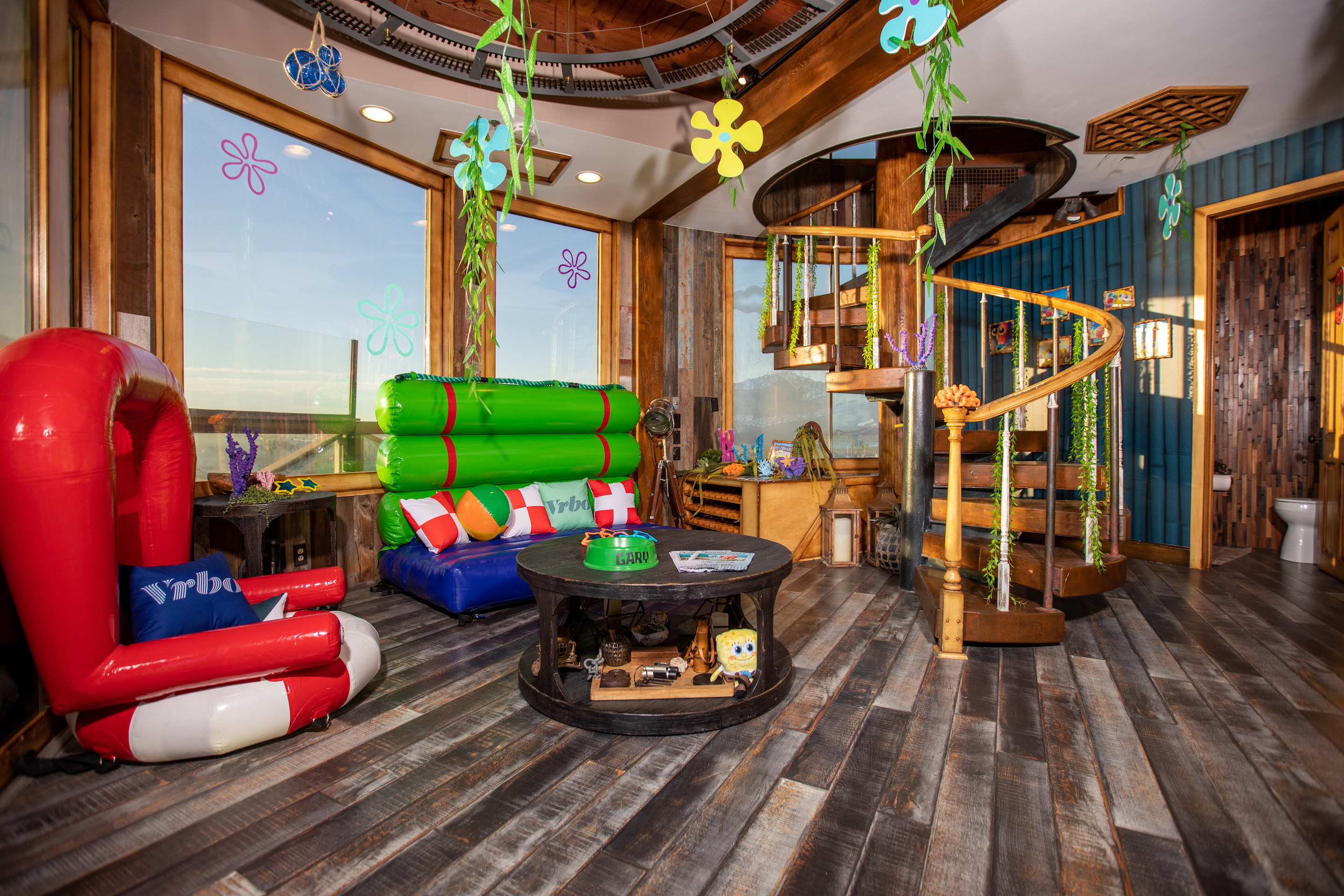 The entry which shows Spongebob's red chair made of a life preserver and a green couch